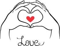 Mani che fanno un gesto del cuore Fotografia Stock