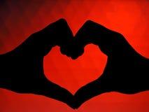 Mani che formano una figura del cuore Fotografia Stock Libera da Diritti