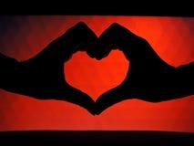 Mani che formano una figura del cuore Immagine Stock Libera da Diritti