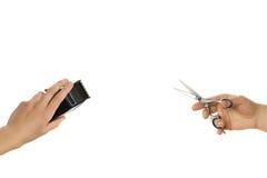 Mani che giudicano tosatrice e forbici, isolate su bianco Fotografia Stock Libera da Diritti