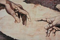 Mani che indicano murale fotografia stock libera da diritti