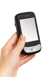 Mani che lavorano ad uno smartphone Immagine Stock