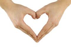 Mani che modellano cuore Fotografie Stock