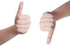 Mani che mostrano i pollici su e giù Immagini Stock Libere da Diritti