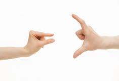 Mani che mostrano le dimensioni differenti - da piccolo a grande Immagini Stock