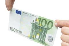 Mani che tengono euro 100 Fotografia Stock Libera da Diritti