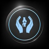Mani che tengono ginocchio-giunto - icona di protezione Fotografia Stock Libera da Diritti