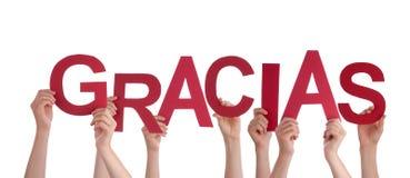 Mani che tengono Gracias rosso Immagini Stock Libere da Diritti