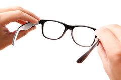 Mani che tengono i vetri classico-designati Fotografie Stock