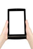 Mani che tengono il pc della compressa del touch screen Fotografia Stock Libera da Diritti