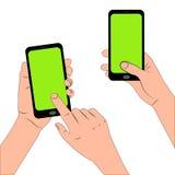 Mani che tengono il telefono di tocco Immagine Stock