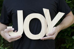 Mani che tengono la gioia di parola Fotografie Stock Libere da Diritti