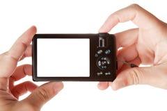 Mani che tengono la macchina fotografica digitale della foto Immagine Stock
