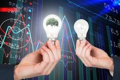 Mani che tengono le lampadine grafiche Immagine Stock Libera da Diritti