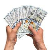 Mani che tengono manciata di soldi Immagini Stock