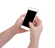 Mani che tengono telefono cellulare Fotografia Stock