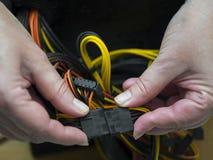 Mani con i connettori Fotografia Stock Libera da Diritti