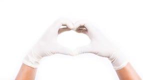 Mani con i guanti del lattice Fotografia Stock