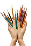 Mani con i pastelli Fotografie Stock