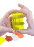 Mani con i pezzi di colore di sapone fatti a mano Immagine Stock