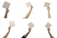 Mani con la nota Fotografie Stock