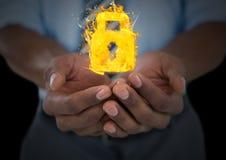 mani con le icone del fuoco della serratura più Priorità bassa nera Immagini Stock Libere da Diritti