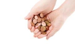 Mani con le monete Fotografia Stock
