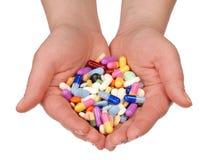 Mani con le pillole Fotografia Stock