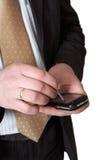 Mani con lo smartphone Fotografia Stock Libera da Diritti