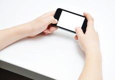 Mani con lo smartphone Fotografia Stock