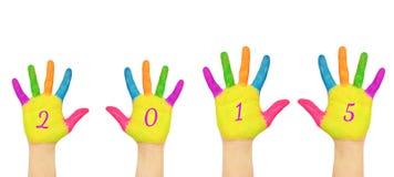 Mani dei bambini che formano numero 2015 Immagine Stock