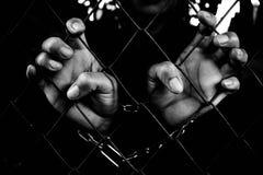 Mani dei prigionieri Immagine Stock