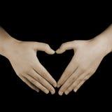 Mani del cuore di amore Fotografia Stock