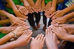 Mani del gruppo insieme Immagine Stock