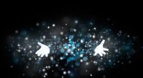 Mani del mago con magia immagini stock