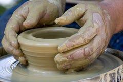 Mani del vasaio Fotografia Stock