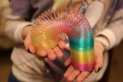 Mani dell'arcobaleno del giocattolo Immagine Stock