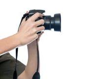 Mani dell'uomo che tengono la macchina fotografica Fotografia Stock