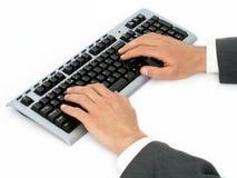 Mani dell'uomo d'affari sulla tastiera di calcolatore Fotografia Stock Libera da Diritti