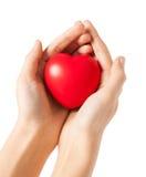 Mani della donna con cuore Fotografia Stock Libera da Diritti