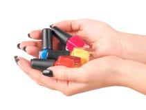 Mani della donna con gli smalti Immagini Stock Libere da Diritti