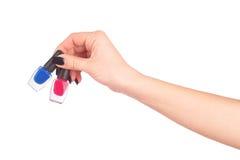 Mani della donna con gli smalti Immagini Stock