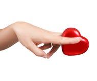 Mani della donna con le forbici e cuore isolato Immagine Stock Libera da Diritti