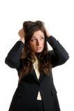 Mani della donna di affari sulla testa dovuto guasto Fotografia Stock