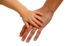 Mani della madre e del bambino fotografia stock
