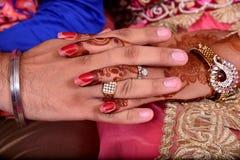 Mani delle coppie Fotografia Stock