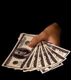 Mani delle donne con i pacchetti dei dollari Immagine Stock
