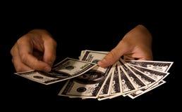 Mani delle donne con i pacchetti dei dollari Fotografie Stock Libere da Diritti