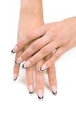 Mani delle donne con un manicure piacevole. Fotografia Stock Libera da Diritti