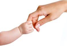 Mani delle madri e del bambino isolate su bianco Immagini Stock Libere da Diritti
